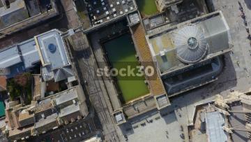 Overhead Rotating Drone Shot Of Roman Baths In Bath, UK