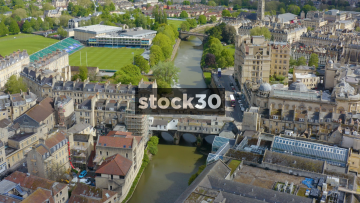 Overhead Drone Shot Flying Over River Avon And William Pulteney Bridge In Bath, UK
