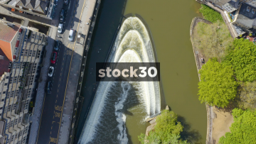 Overhead Rotating Drone Shot Of Pulteney Weir On The River Avon In Bath, UK