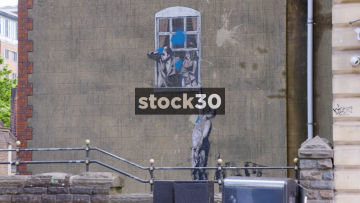Banksy's Well Hung Lover Street Art In Bristol, UK