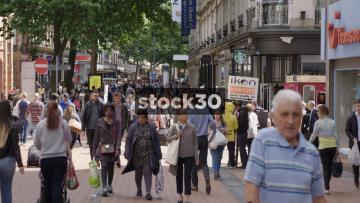 Slow Motion Shot Of Pedestrians On New Street In Birmingham. Angle 2. UK