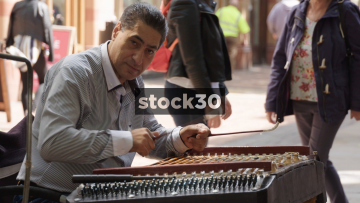 Busker Playing Cimbalom On New Street In Birmingham, UK