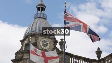 Slow Motion Shot Of Flags On Top Of Cathedral Church Of St.Philip In Birmingham, UK