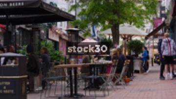 People Dining Outdoors By Honest Burgers On Duke Street In Brighton, UK