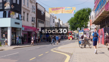Western Road In Brighton With Traffic And People Passing By, UK