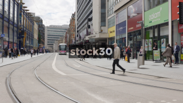 Tram Passing On Corporation Street In Birmingham, UK