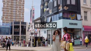 Western Road In Brighton, People Passing By Sole Trader And Kokoro Stores, UK