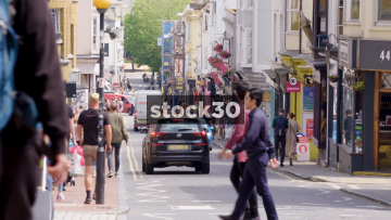 Trafalgar Street In Brighton With People And Traffic, UK