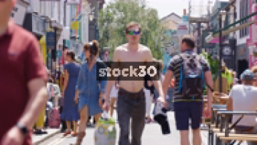 Slow Motion Shot Of People Walking Down Sydney Street On A Sunny Day In Brighton, UK