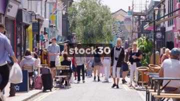 Pedestrians On Sydney Street In Brighton, UK