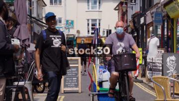 People Interacting On Sydney Street in Brighton, UK