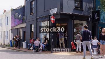 People Outside The Flour Pot Bakery On Gloucester Street In Brighton, UK