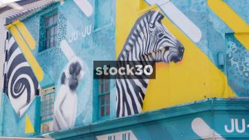 Street Art Of Monkey And Zebra Above Ju Ju Clothing Store On Kensington Street In Brighton, UK