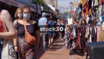People Walking Down Kensington Gardens And Browsing Shops In Brighton, UK