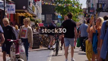People On Gardner Street In Brighton, Slow Zoom Out, UK