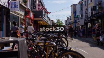 Bicycles And People On Gardener Street In Brighton, UK