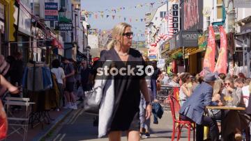 View Down Busy Gardner Street In Brighton, UK