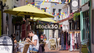 People Dining Outside Cafe On Market Street In Brighton, UK
