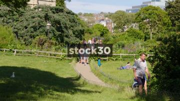 People Walking Through Pavilion Gardens In Brighton, UK