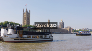 Old London Cruise Boat On The River Thames With Houses Of Parliament In Background, UK