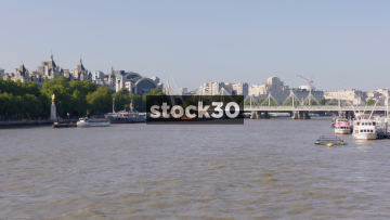 View Over The River Thames In London Of The Hungerford Bridge And Charing Cross Railway Station, UK