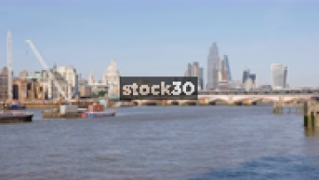 Wide Shot Of The River Thames In London With Blackfriar's Bridge And St Paul's Cathedral, UK