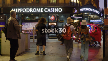 People Outside The Hippodrome Casino In London At Night, UK