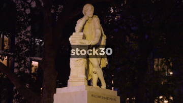 Statue Of William Shakespeare In Leicester Square, London At Night, UK