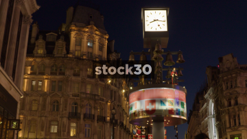 Swiss Glockepspiel Clock In Leicester Square, London, At Night, UK