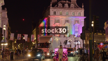 Piccadilly Circus In London With The Swan & Edgar Building Illuminated With Rainbow Colours, UK