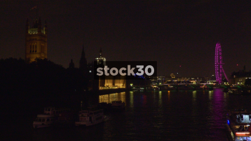 The River Thames, London Eye And Houses Of Parliament In London At Night, UK