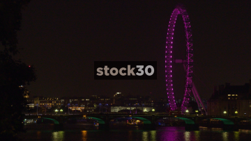 The London Eye And Westminster Bridge Over The River Thames In London At Night, UK