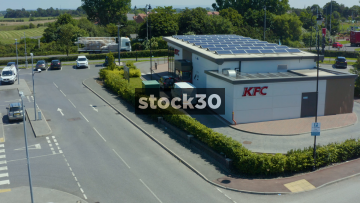 Drone Shot of KFC Drive Thru With Solar Panels On Roof In Fylde, Lancashire, UK