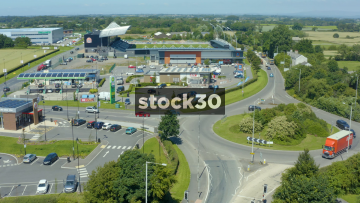 Rotating Drone Shot Of Roadside Service Area, AFC Fyle Stadium And Countryside In Lancashire, UK