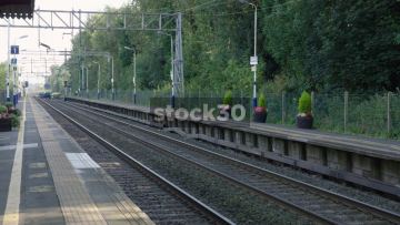 Two Shots Of Passenger Trains Passing At Goostrey Station In Cheshire, UK