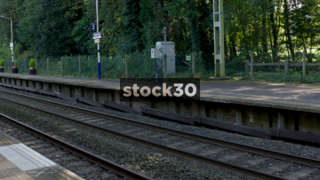 Freightliner Goods Train Passing By At Goostrey Station In Cheshire, UK