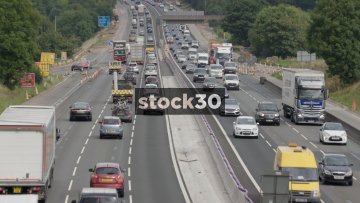 Slow Zoom Out From Busy M6 Motorway Near Junction 18 In Cheshire, UK