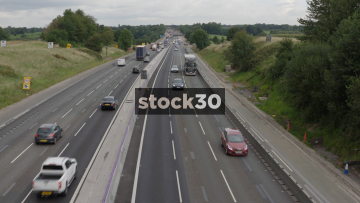 Zoom In To Busy M6 Motorway Near Junction 18 In Cheshire, UK