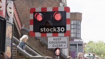 Train Passing At Pedestrian Crossing, UK