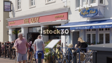 People Eating And Drinking By The Quay In Poole, UK