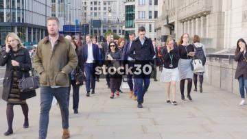 Slow Motion Shot Of Pedestrians Walking On London Bridge, UK