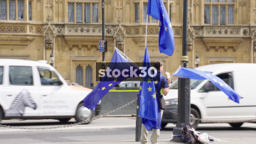 Man With EU Flags Outside Westminster In London, UK