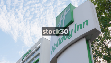 Timelapse Of Clouds Moving Past A Holiday Inn Sign In London, UK