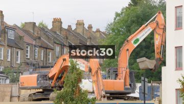 Two Diggers On A Construction Site In London, UK