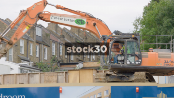 A Digger Working On A Construction Site In London, UK